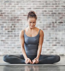 Young Woman Doing Yoga Meditation Exercise. Stock photo.
